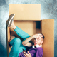Introvert concept. Man sitting inside box and working with phone - PhotoDune Item for Sale