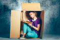 Introvert concept. Man sitting inside box and reading book