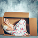 Introvert concept. Woman sitting inside box and working with laptop - PhotoDune Item for Sale
