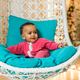Portrait of mixed race child at home sitting in the armchair - PhotoDune Item for Sale