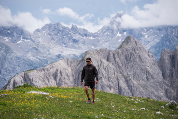 Hiker in the Dolomites mountains in Italy - Stock Photo - Images