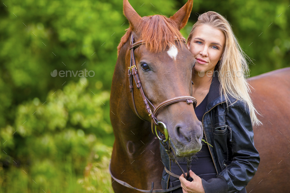Beautiful smiling woman with her arabian horse in the field - Stock Photo - Images