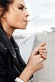 portrait of young woman smoking cigarette