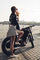 couple sitting on motorcycle at sunset