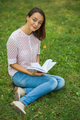 Cute young woman reading the book