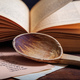 Wooden spoon and a vintage book - PhotoDune Item for Sale