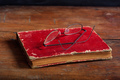 Old book and eye glasses on wooden desk - PhotoDune Item for Sale