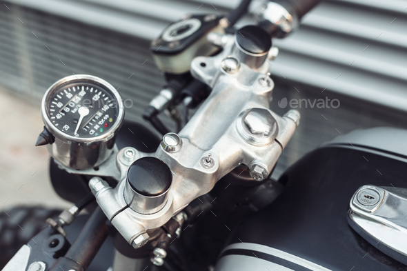 motorcycle standing in dark building in rays of sunlight - Stock Photo - Images