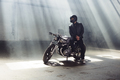 biker wearing jeans and leather jacket sitting on motorcycle - PhotoDune Item for Sale