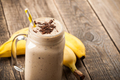 Banana chocolate smoothie and banana on wooden table - PhotoDune Item for Sale