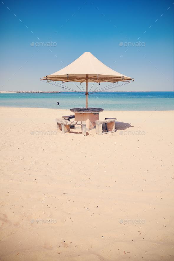 Umbrella on an empty tropical beach.