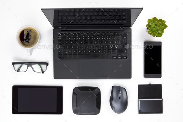 Various Devices Arranged On White Office Desk - Stock Photo - Images