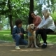 Positive Family Resting in the Park with Their Dog - VideoHive Item for Sale