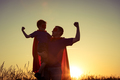 Father and son playing superhero at the sunset time. - PhotoDune Item for Sale