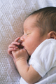 Cute newborn baby sleeps in white