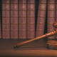 Download Gavel on the background of vintage lawyer books. Concept of law from PhotoDune
