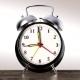Vintage Black Alarm Clock on White Background. Time Concept.