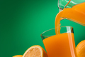 Pouring orange juice into a glass - PhotoDune Item for Sale