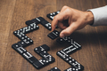 Businessman playing with dominoes - PhotoDune Item for Sale