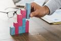 Businessman building a successful financial graph - PhotoDune Item for Sale