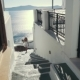 Young Sexy Woman Is on the Greek Island Santorini in a White Dress and and Straw Hat White Greek - VideoHive Item for Sale