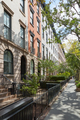 Townhouse buildings in Chelsea, New York in a sunny day - PhotoDune Item for Sale