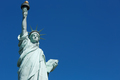 Statue of Liberty, blank blue sky space in New York - PhotoDune Item for Sale