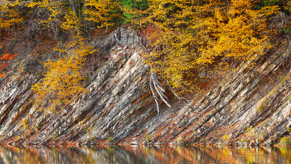 Rocky shore of lake in autumn time