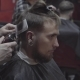 Barber Cuts the Hair of the Client with Trimmer in Barbershop - VideoHive Item for Sale