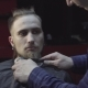 Barber Cuts Beard Using Trimmer at a Barber Shop - VideoHive Item for Sale
