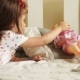 Girl Playing with Doll - VideoHive Item for Sale