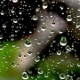 Drops of Rain on the Window on the Background of the House - VideoHive Item for Sale