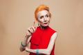 Thinking mature redhead fashion woman