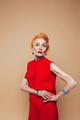 Amazing mature redhead fashion woman posing