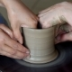 Hands of Two People Create Pot on Potter's Wheel - VideoHive Item for Sale