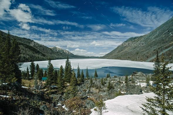Multinskoe lake with snow. Altai mountains