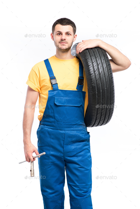 Tire serviceman isolated on white background - Stock Photo - Images
