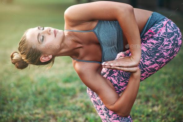 Flexible woman meditating, yoga training - Stock Photo - Images
