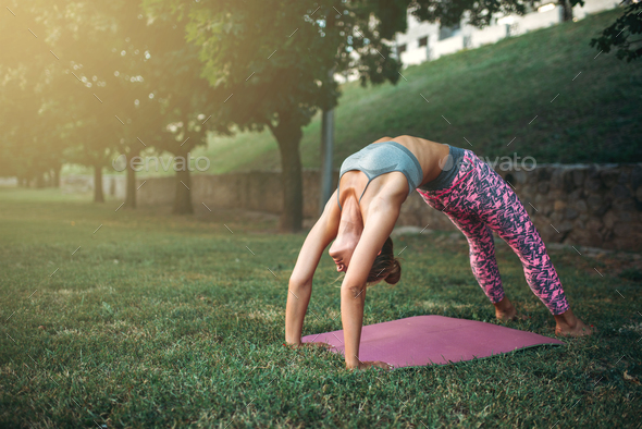 Flexible woman meditating, yoga training - Stock Photo - Images