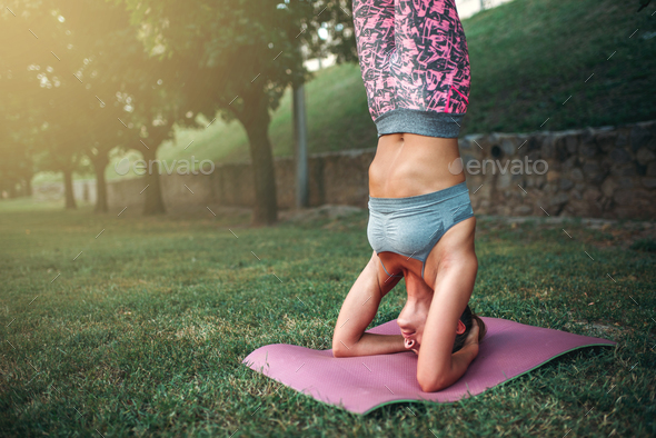 Flexible woman, yoga concentration exercise - Stock Photo - Images