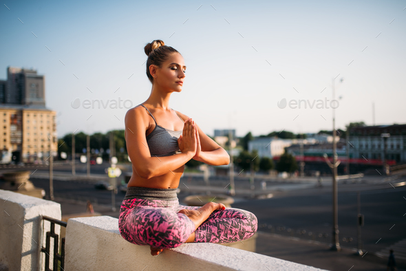 Beautiful young woman relax in yoga pose - Stock Photo - Images