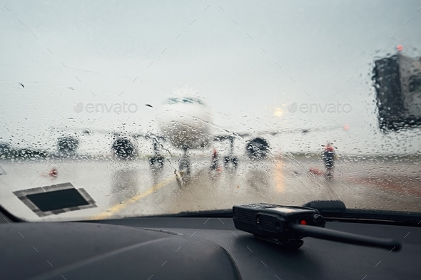 A busy airport in the rain - Stock Photo - Images