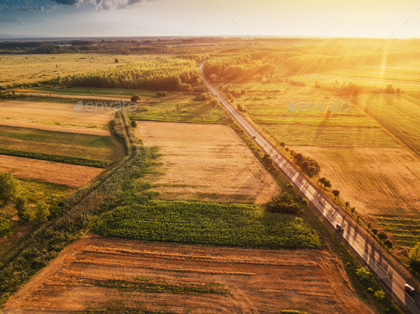 Beautiful aerial view of countryside and fields in sunset - Stock Photo - Images