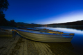 Illuminated rowboats at a lake at night - PhotoDune Item for Sale