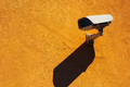 Security camera on yellow wall - PhotoDune Item for Sale