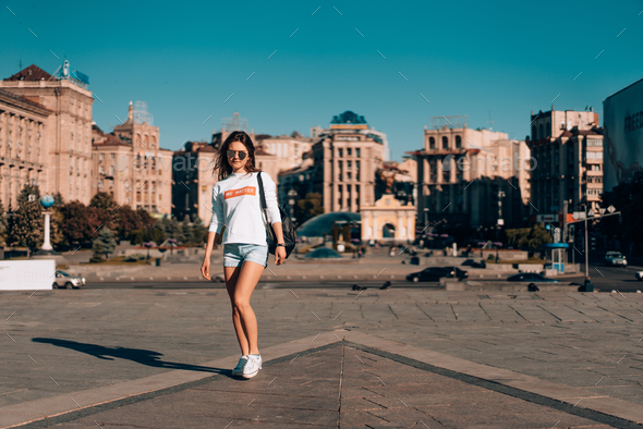 Young girl on the city street - Stock Photo - Images