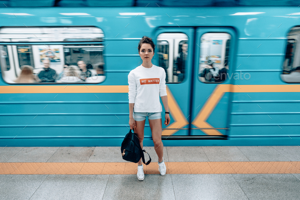 Beautiful young girl posing on metro station - Stock Photo - Images