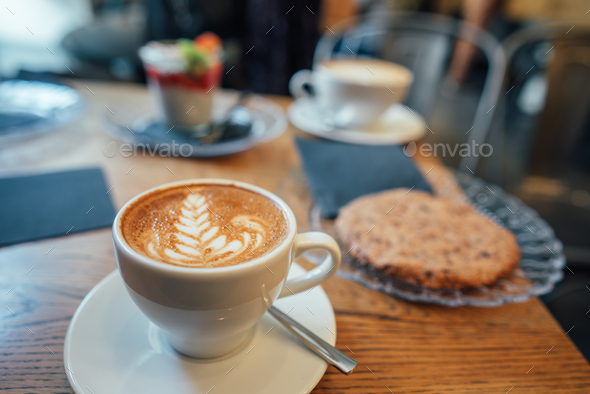 Cappuccino with beautiful foam and spoon in cup - Stock Photo - Images