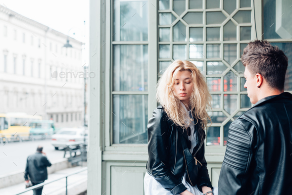 Guy and girl in black jackets on a city street - Stock Photo - Images