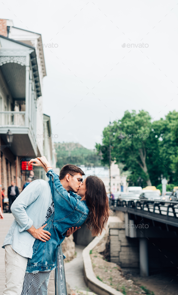 Guy and girl on a city street - Stock Photo - Images